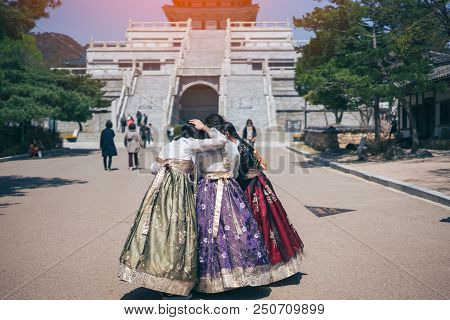 Group Friend Of Young Asian Woman Traveler Looking Photo In Smartphone In Korean National Dress Or H