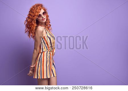 Young Pretty Redhead Girl Smiling In Studio On Purple. Beautiful Woman In Stylish Summer Outfit, Tre