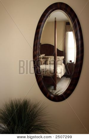 Oval Mirror Reflecting Bed