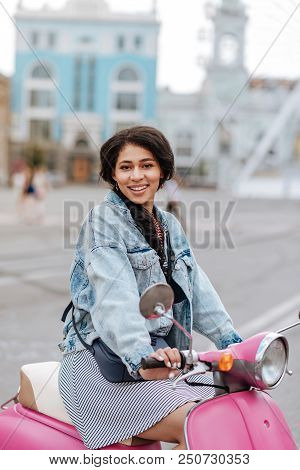 Pink Motorbike. Jovial Merry Woman Sitting On Motorbike And Looking At Camera
