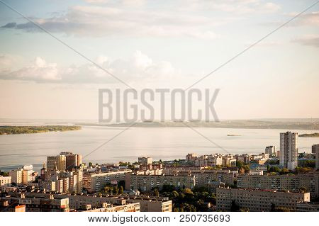 Saratov, Russia, view of the houses, the Volga River, the bridge to Engels. The landscape of the city from a height. poster