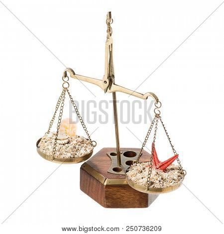 Scales of justice with sand and sea shells over blue background for judiciary holiday concept.