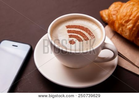 Cup Of Coffee With Wifi Sign On The Foam. Free Access Point To The Internet Wifi. I Like Coffee Brea