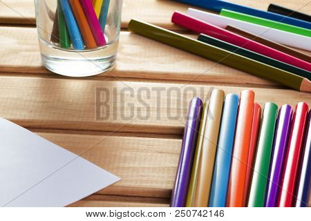 Set Of Color Pencils On Wooden Table