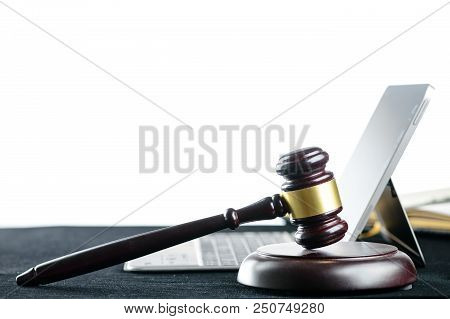 Wooden Judges Gavel On A Computer Keyboard On Light Background. Cyber Law And Crime Internet Concept