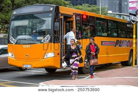 Johannesburg, South Africa - 15 February, 2018: Commuters Climbing Out Of Bus In City Centre.