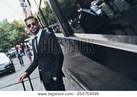 Confident And Successful. Handsome Young Man In Full Suit Keeping Hand In Pocket While Standing Outd