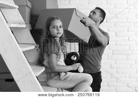 Kid And Guy Move In Or Move Out. New Home And Family Concept. Daughter And Father Hold Teddy Bear, B