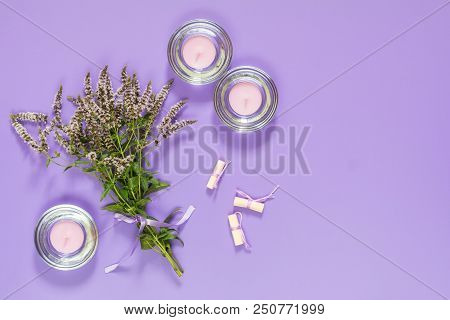 Beautiful Amazing Mint Bouquet  With Violet Ribbon And Candles On Violet Surface. Top View, Copy Spa
