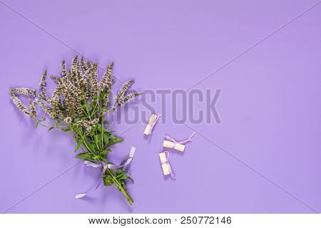 Beautiful Amazing Mint Bouquet  With Violet Ribbon On Violet Surface. Top View, Copy Space.