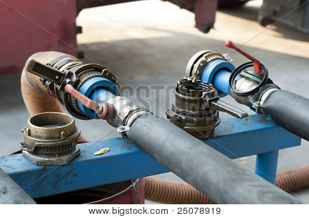Truck Hoses For Fuel Station, Pumps And Oil Barrels