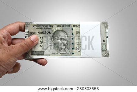 Indian Currency Rupee 500 Bank Note Bundle In A Hand