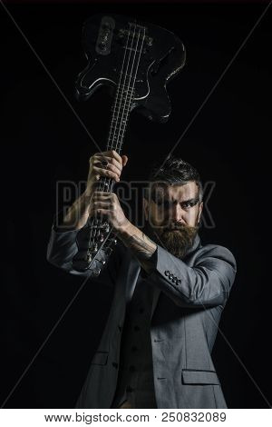Music Concept. Bearded Man Hold Guitar In Hands At Music Festival. Man With Musical Instrument, Musi