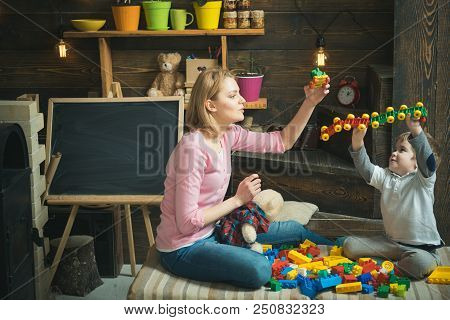 Friendship Concept. Woman And Little Child Play With Plastic Toys, Friendship. Friendship And Family