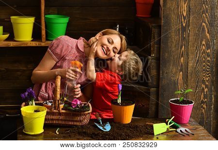 Florist Concept. Little Kid Kiss Florist Woman Spraying Flower. Home Florist At Work. Florist Shop.