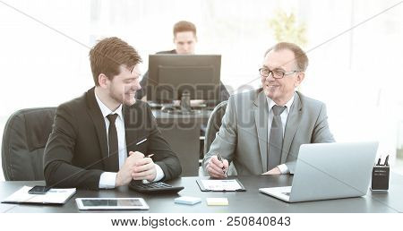 Business People Discussing Document Stock At The Office.photo With Place For Text
