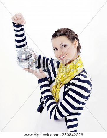 pretty young woman holding a mirror ball.isolated on white background poster