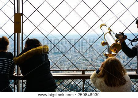 Paris, France - September 22 2017: A Family Enjoys The View From The First Platform Of The Eiffel To