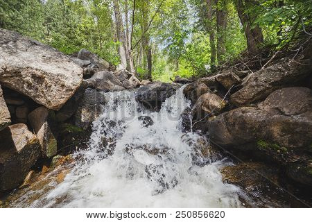 A Small Waterfall Pours Down Rocks In The Sawtooth National Forest Of South-central Idaho, Usa.