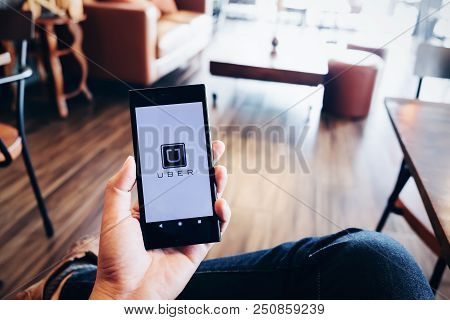 Chiang Mai,thailand - July 07, 2018 : A Man Hand Holding Uber App Showing On Sony Mobile Phone At De
