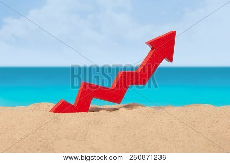 Beach Sea And Arrow Chart Up In The Sand. The Concept Of Sales Growth, Growth In Prices In The Turis