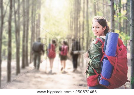 Young Asian People Hiking In The Forest During Summer At Sunset,travel,tourism And Teamwork Concept