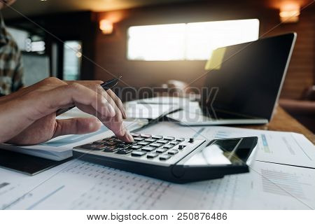 Businessman Working With Calculator For Financial Document In Office. Male Accountant Doing Accounti