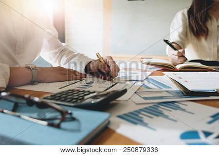 Business People Investment Consultant Analyzing Company Annual Financial Report Balance Sheet Statem