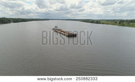 Aerial View:barge With Cargo On The River Volga. River Tugboat Moves Cargo Barge, Cargo Ship On The