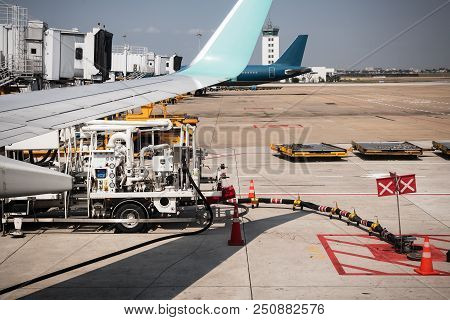 Loading Cargo On The Plane In The Airport,refueling Aircraft,travel And Transport Concept.