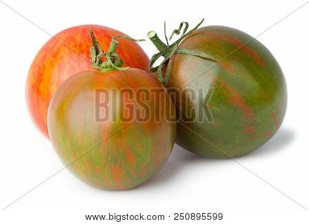 Three Various Colored Tomatoes Isolated On White Background