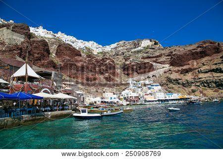 Santorini, Greece- June 12, 2016: Ammoudi village with fishing boats on Santorini island, Greece.