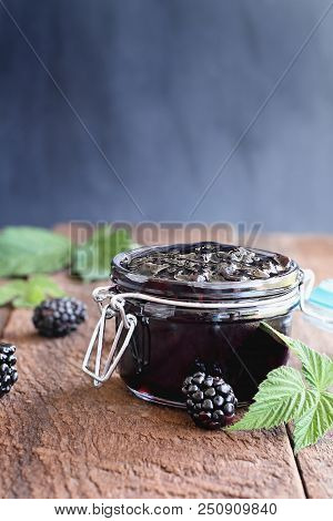 Homemade Blackberry Preserves In A Canning Glass Bail Jar With Attached Lid. Selective Focus On Jam.