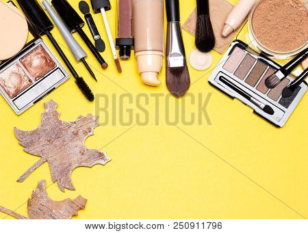 Autumn Makeup Frame Background. Beauty Products For Natural Make-up With Maple Leaves Made Of Bark.
