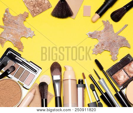 Autumn Makeup Background. Make Up Products And Accessories With Maple Leaves Made Of Bark. Top View,