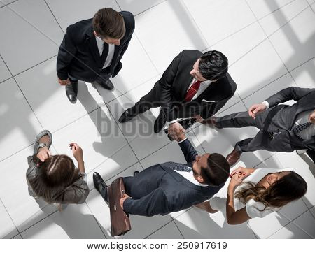 top view. handshake business partners at the meeting