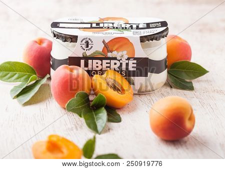 London, Uk - July 28, 2018: Pack Of Liberte Origins French Style Yogurt With Apricot Flavour On Wood