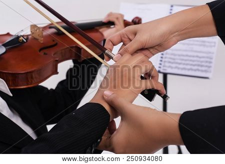 The Violin Teacher Hands Is Teaching The Violin Student,by Touch Student Hand For Using Bow To Play