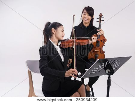 The Violin Teacher Is Teaching The Violin Student,teach The Method To Use Bow For Playing And How To