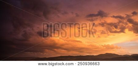 Dusk or dawn concept. Red cloudy sky at sunset, mountain range, banner, copy space, wallpaper.