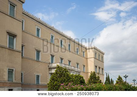 Historic buildings concept. Neoclassical Greek parliament building in the centre of the city of Athens on a sunny day, wallpaper.