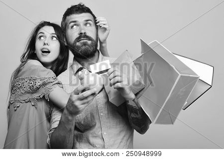 Couple In Love Holds Shopping Bags On Pink Background. Man With Beard Holds Credit Card And Money Bo