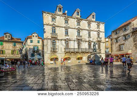 Split, Croatia - September 29 2017: Visitors Pass Through Trg Brace Radic Or The Fruit Square Visiti