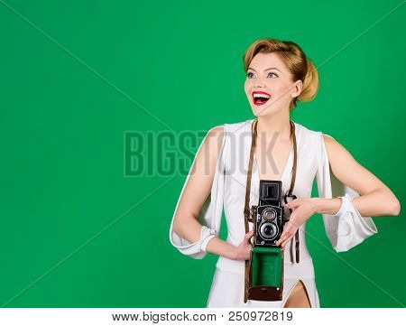 Photographer. Vintage Photography Concept - Woman In Retro Style With Vintage Photo Camera. Happy Gi