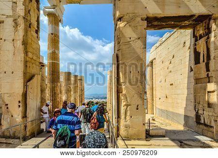 Athens, Greece - September 12 2017: Tourists Pass Through The Ancient Ruins On Acropolis Hill In Ath