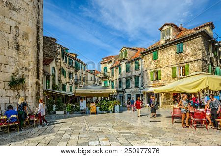 Split, Croatia - October 1 2017: Tourists Enjoy Cafes And Shops On An Early Autumn Afternoon On The