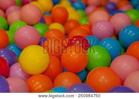 Colorful Child Balls. Multi-colored Plastic Balls. Achildren's Playroom. Background Texture Of Multi