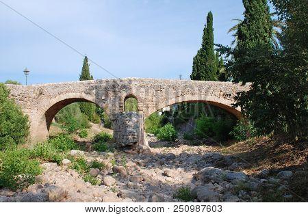 The Roman bridge across the Torrent de Sant Jordi at Pollenca on the Spanish island of Majorca.