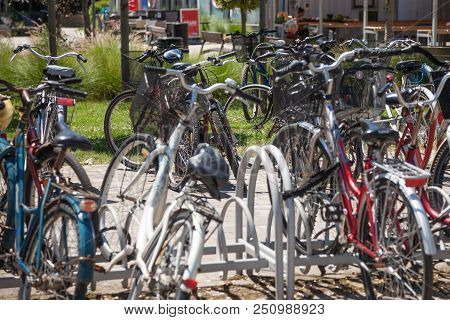 Szeged, Hungary - June 3, 2018: Bicycles Raks Full Of Bikes Parked By Communters Near The Szeged Mar