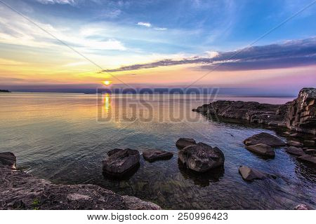 Summer Sunset At The Lake. Beautiful Sunset Over The Horizon Of Lake Superior At Copper Harbor In Th